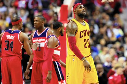 WASHINGTON, DC - NOVEMBER 21: LeBron James #23 of the Cleveland Cavaliers looks on during a first half timeout against the Washington Wizards at Verizon Center on November 21, 2014 in Washington, DC. NOTE TO USER: User expressly acknowledges and agrees that, by downloading and or using this photograph, User is consenting to the terms and conditions of the Getty Images License Agreement. (Photo by Rob Carr/Getty Images) ** OUTS - ELSENT, FPG - OUTS * NM, PH, VA if sourced by CT, LA or MoD **