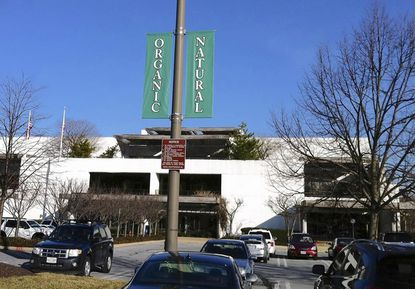 Howard Hughes Corp. placed banners and flags in front of its downtown Columbia headquarters Feb. 9 to demonstrate alternative ways for using the building.