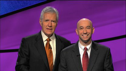 David Greisman, right, is pictured here with Alex Trebek during his recent stint on Jeopardy. Greisman is scheduled to appear on the show on Nov. 20.