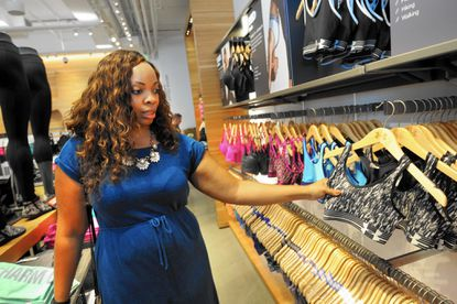Jennifer Brown, 30, from Pikesville, shops for bras at Under Armour in Harbor East.