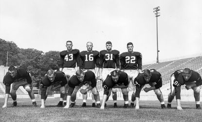 Army's 1964 starters line up for a photo.