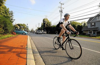 Dan Healy, of Owings Mills, takes a training ride along Reisterstown Road Aug. 13. In memory of a close friend who died of brain cancer in July, Healy will ride more than 150 miles this weekend in the Ride to Conquer Cancer to benefit the Johns Hopkins Kimmel Cancer Center.