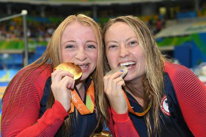 Gold medalist Mckenzie Coan, left, and silver medalisat Cortney Jordan pose with their medals after medal ceremony for the women's 400m freestyle - S7 during Day 7 of the Paralympic Games at the Olympic Aquatics Stadium in Rio de Janeiro on Sept. 14, 2016.