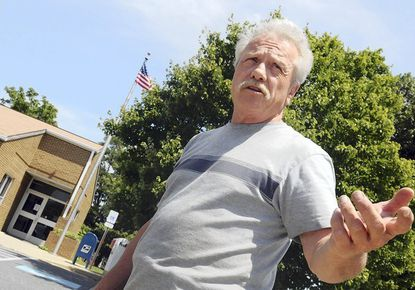 """Bill Dailey, of Highland, former postmaster at the Highland Post Office, said it """"was a shame"""" that the Clarksville Post Office was closing."""