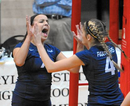 Perryville's Rebekah Hanshaw, left, and her teammate, Kylie Shiflett, celebrate beating McDonough in Tuesday's 1A state semi final at College Park. Perryville advances to the state final at 6 p.m. Friday against Smithburg.