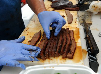 George Hensler of Street lays out his team's smoked brisket on a cutting board in this file photo from a previous year's Maryland State BBQ Bash.