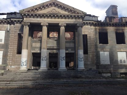 A $10,000 reward has been posted in an effort to identify those who started the Sept. 21 fire that gutted Memorial Hall on the former Bainbridge Naval Training Center in Cecil County.