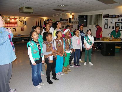 Members of Girl Scout Troop 2339 from Owings Mills sing Christmas Carols to the Veterans.