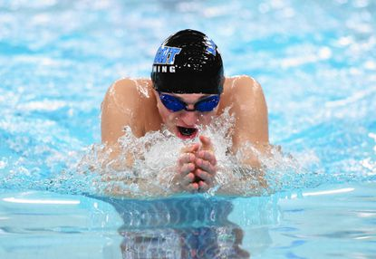 C. Milton Wright's Tyler Kosar cuts through the water as he competes in the 100 yard Breaststroke event during Wednesday night's Harford County Boys swimming championships at Magnolia Middle School.