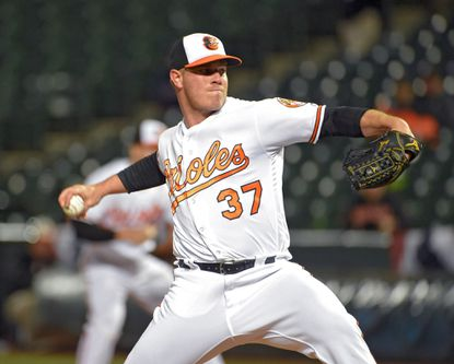 Orioles relief pitcher Dylan Bundy (37) makes his first major league appearance since 2012 during the eighth inning against the Minnesota Twins at Camden Yards on April 7, 2016.
