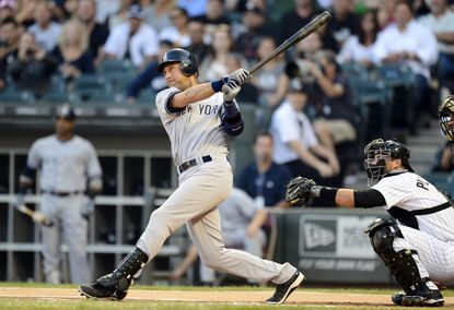 Derek Jeter hits a solo home run in the first inning Tuesday night, passing former Oriole Eddie Murray for 11th on baseball's all-time hit list.