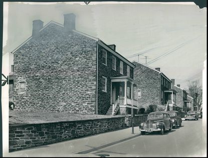 The distinctive dark stone used to build workers' cottages was quarried from the Jones Falls. The cottage style of housing helped to distinguish the Baltimore-area mill town from those in England, according to Nathan Dennies. Photo dated March 30, 1951. (Baltimore Sun archives)