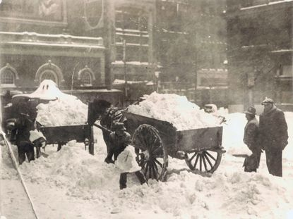 Horse carts are used to remove snow from Court House Plaza in Baltimore during the Knickerbocker Storm. on January 27, 1922. The storm took its name from the resulting collapse of the Knickerbocker Theatre in Washington, D.C. which killed 98 people and injured 133.