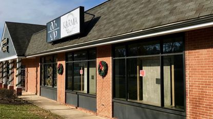 The empty storefront windows of Lutherville consignment boutique Karma are shown on Nov. 29 after the store was emptied the night of Nov. 18 by one of its co-owners amid a business partner dispute.