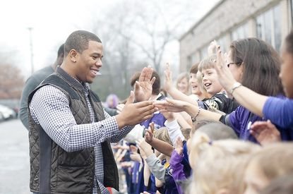 Baltimore Ravens running back Ray Rice greets students at the Immaculate Heart of Mary School in Towson on Dec. 6. The school won $10,000 in the NFL Play 60 contest.