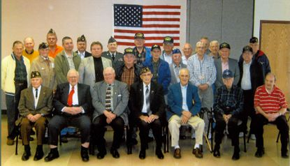 Ten years ago, many Carroll County veterans stopped for a picture after an annual Westminster Senior Center Veteran's Day program on Tuesday, Nov.10, 2009. Seated left to right: Gordon Spittell, Jessie Chaves, Phillip Short, George Miller, Cliff Keffer, George Martin, and Frank Martin. 2nd row left to right: John Kraus, Arthur Hauck, Todd Caple, Jerry Barnes, John Boone, William Haifley, John Corkran, Ed Stuller, Wilbur Haines, and Russ Proescher. 3rd row left to right: Howard Evans, Bill Rau III, Pat Hauke, Harvey Dillon, Vernon Miller, Ray Brown, Curtis Hatcher, Bill Slade, Jack Lippy, and Joe Fisher.