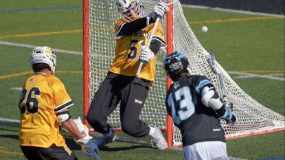 Towson long-stick midfielder Koby Smith (26) watches a shot by Johns Hopkins attackman Kyle Marr (13) deflect off the back of the net behind goalkeeper Tyler Canto (51). (Karl Merton Ferron / Baltimore Sun Staff) [ LAX JOHNS HOPKINS TOWSON ] 8000 York Rd / 37rt (DSC_1363.JPG)