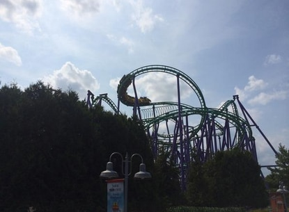 A roller coaster with 24 riders aboard was stalled atop a loop at Six Flags America in Largo. Crews from Prince George's County Fire Department were handling the tactical rescue.