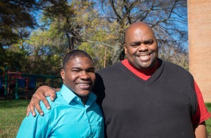 Markel Jackson, left, was shot to death Saturday afternoon. In this photo from 2015, he is shown with Robert Bell, the social worker who runs Promise Place, a shelter in Prince George's County.