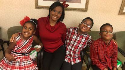 Tanika Davis and her kids in holiday regalia.
