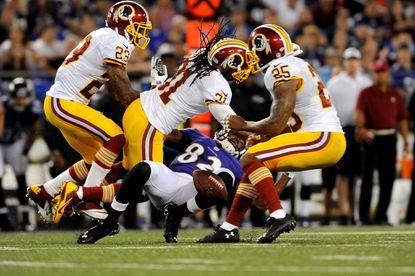 Redskins safety Brandon Meriweather hits Torrey Smith during last Saturday's preseason game.