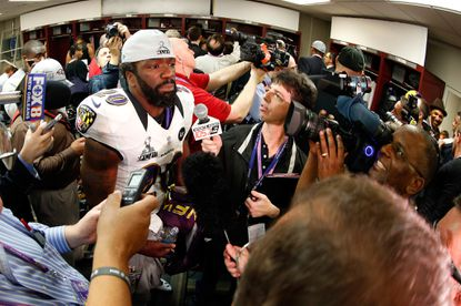Ed Reed of the Ravens talks to reporters in the locker room after their 34-31 win against the San Francisco 49ers during Super Bowl XLVII at the Mercedes-Benz Superdome.