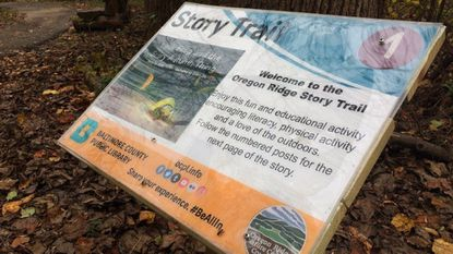 """The latest installation for the Baltimore County Public Library's Story Trail at Oregon Ridge Park features """"Little Frog and the Scary Autumn Thing."""" The book is displayed on a trail near the park's Nature Center."""