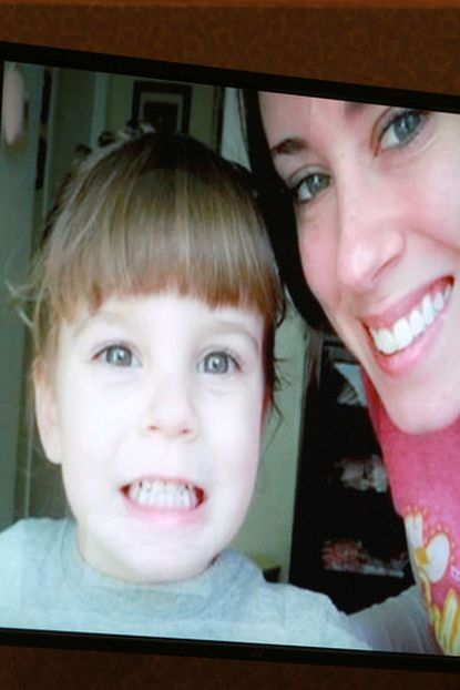 An image displayed on a courtroom monitor shows a photo entered into evidence in the Casey Anthony trial at the Orange County Courthouse on Friday, June 10, 2011. The photo shows Caylee Anthony and her mother Casey. An expert witness used this photo to superimpose an image of Caylee's skull to mark where duct tape found on the remains would have been positioned on the child when she was alive.