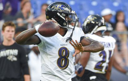Lamar Jackson throws the ball during pregame warmups. The Green Bay Packers played the Ravens in a preseason game at M&T Bank Stadium on Thursday, August 15.