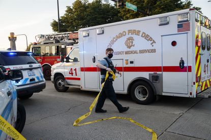 An ambulance arrives at the scene where a 34-year-old woman was fatally shot along in the early hours of Saturday July 4, 2020 in Chicago.