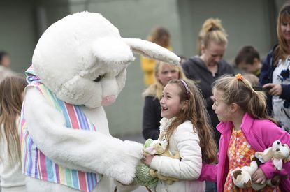 The Easter bunny visits with Sasha Schoenherr and Zoe Croker, right, both 7, during a massive Easter egg hunt sponsored by the Mount Airy Lions Club Sunday, March 27, 2016.