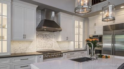 As subway tile becomes a backsplash standard, homeowners are turning to stylish tweaks like the gray veining in this kitchen by Hunt Valley Tile & Stone and Greenleaf Construction.