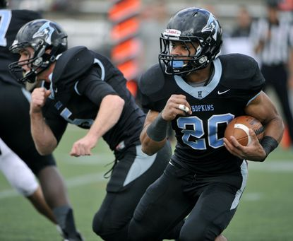Johns Hopkins running back Brandon Cherry runs the ball after getting a hand off from quarterback Robbie Matey.