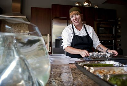 Shirlé Hale-Koslowski, owner and executive chef of Four Corners Cuisine, prepares meals in the kitchen of one of her clients.