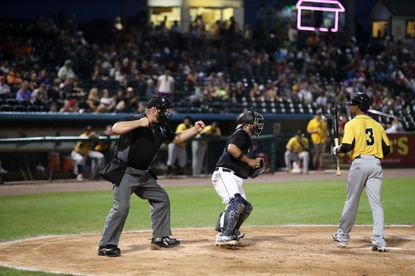 Harford County resident Drew Hoagland calls a strikeout while umpiring a York Revolution game. Hoagland was a substitute plate umpire in Aberdeen Thursday night at the IronBirds-Cyclones game.