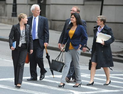 Michael Schatzow (second from left) and Janice Bledsoe (right) are the primary prosecutors in the case against six Baltimore police officers charged in the death of Freddie Gray.