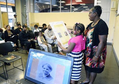 Descendants of Harriet Tubman -- from right, Patricia Ross Hawkins, of Easton, and her daughter Maya Ross Hawkins-Bailey, 8 -- make a presentration during a gathering at the Reginald F. Lewis Museum of Maryland African American History & Culture to kick off the celebration of Tubman's centennial commemoration in 2013.