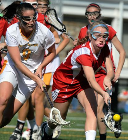 Bryn Mawr's Kassandra Bowling (left) and Roland Park's Megan Lynch battle for a loose ball during the first half Wednesday.