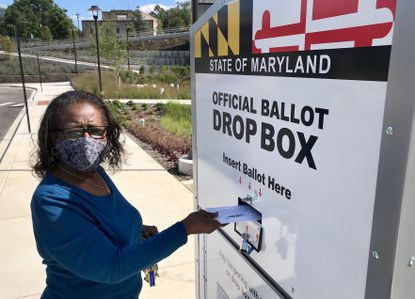 Jeanette Witherspoon casts her ballot at a drop box installed at Morgan State University in Baltimore.