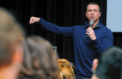 Chris Herren, a former college basketball and NBA player who nearly died from a heroin overdose, speaks to Southern High School students.
