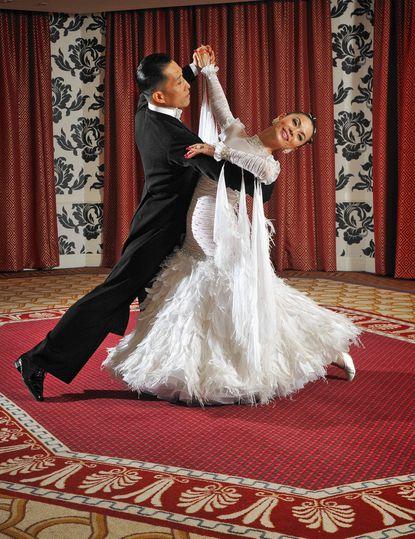 Thomas Yu and Yuko Naululani Yu, of Ellicott City, demonstrate their ballroom dancing technique at the Hotel Monaco.