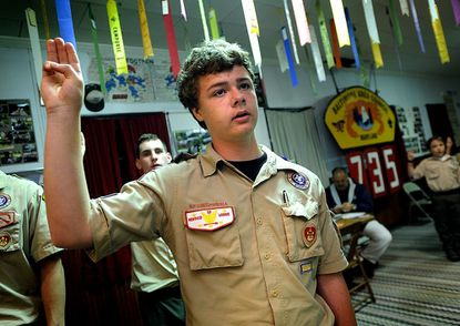 Jack Bitzel, 15, holds the three-finger sign of the Scouts at the close of a meeting of Boy Scout Pack 735 at Cavalry United Methodist Church in Gamber Monday, April 30, 2012. Bitzel, who's father is a scout leader, is going for his Eagle Scout badge.
