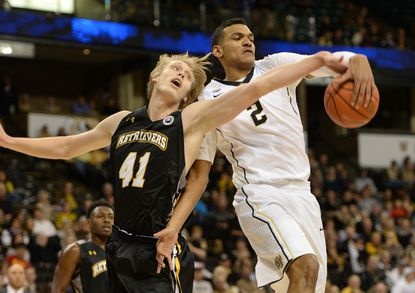 UMBC's Jakob Stenhede (41) and Wake Forest's Devin Thomas (2) battle for a rebound during an NCAA basketball game in Winston-Salem, N.C., on Friday, Nov. 13, 2015.