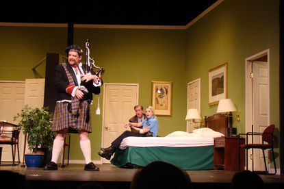 """From left, Jim Adams (as Todd), Eric Small (Agent Frank) and Elsbeth Clay (Officer Billie Dwyer) take part in a scene from Prince George''s Little Theatre''s production of """"""""Unnecessary Farce."""""""