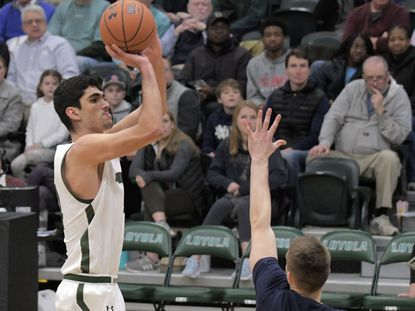 Loyola Maryland forward Santi Aldama, left, will take a look at his NBA draft options while keeping his amateur eligibility.
