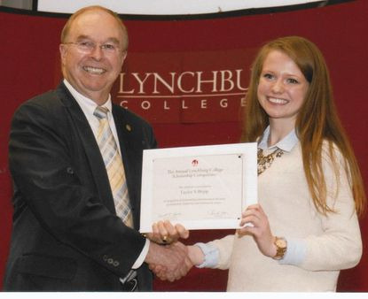 Taylor Bopp vied in the Annual Scholarship Competition at Lynchburg College. Here, Dr. Ken Garren, college president, presents a certificate of participation to her.