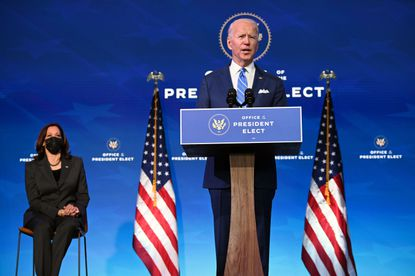 President-elect Joe Biden, flanked by Vice President-elect Kamala Harris, delivers remarks on the public health and economic crises at The Queen theater in Wilmington, Delaware on January 14, 2021. (Photo by JIM WATSON / AFP) (Photo by JIM WATSON/AFP via Getty Images)