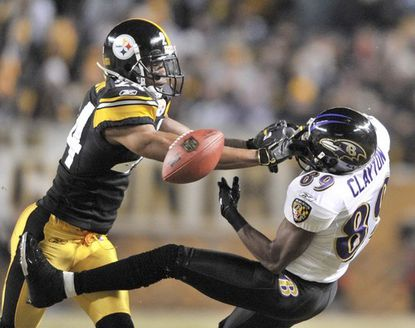 Ravens wide receiver Mark Clayton (right) can't hang on to the ball as he takes a hit from the Steelers' Ike Taylor in the first quarter of the AFC championship game.