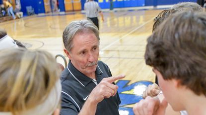 South Carroll coach Jim Carnes talks to his team before they take the floor for the third quarter against Mount Hebron in the opening round of the Liberty Holiday Tournament in Eldersburg Wednesday night.