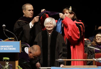 Federal Reserve Board Chair Janet Yellen, center, is hooded for an honorary doctor of laws degree before speaking at the University of Baltimore's fall commencement in Baltimore, Monday, Dec. 19, 2016.